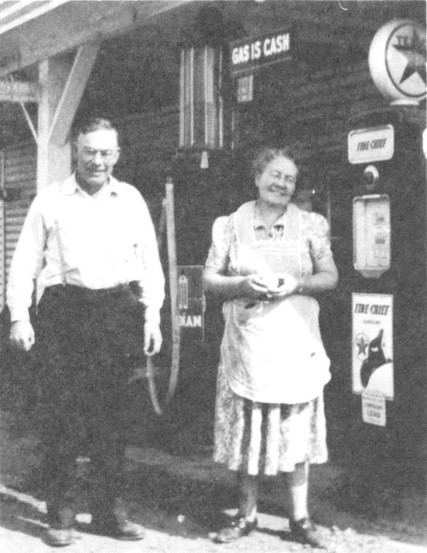 Hattie and Bill Mitchell in front of Lorane Service Station